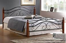 home metal bed frame w wood posts and mattress
