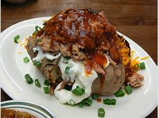 Stuffed Baked Potato Topped With Pecan Smoked Pulled Pork