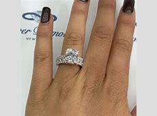 Style #82XD200 is an 18k white gold engagement ring with 1