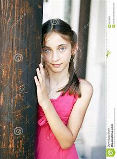 Younger Teens Portrait Of A Young Girl To A Wooden Column Royalty