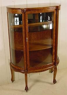 small oak curio cabinet