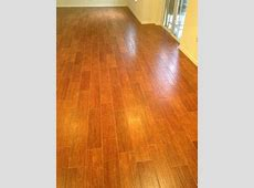 Flooring; Marrazzi Gunstock Oak porcelain tile, Home Depot sable brown sanded grout which looked