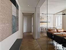 soluzioni per cabina armadio 110 mq con una parete in vetro per dividere soggiorno e