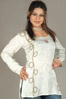 ivory kurti with floral beadwork and self design