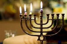 How To Light The Menorah And Hanukkah Students Light The Menorah To Celebrate Hanukkah The