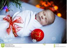 Baby Wrapped In Christmas Lights Photo One Week Old Newborn Baby Wrapped In Blanket Near