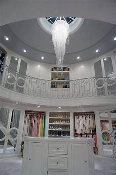 Two One Two Design Stunning Two Story Closet Features A Staircase Leading Up