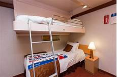 interior cabin with bunk beds on carnival ship