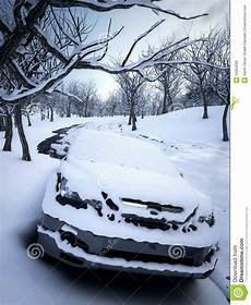 Snow Lights Car Car In Winter Snow Parked In Forest Stock Photography
