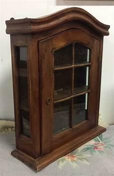 hanging walnut glass curio cabinet