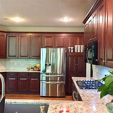 cabinet refacing vs refinishing midwest kitchens