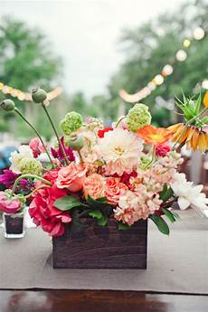 bold flowers in rustic container elizabeth anne designs