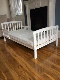 white wooden toddler bed mattress for sale in burnside