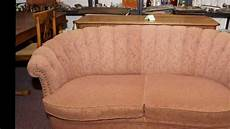 vintage tuft back curved sofa