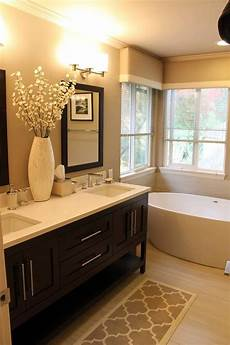 warm toned bathroom with furniture style vanity visit
