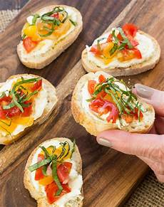 crostini with feta and tomatoes garnish with lemon