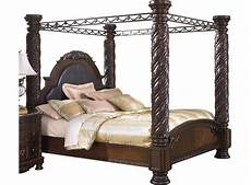 shore king canopy bed in wood