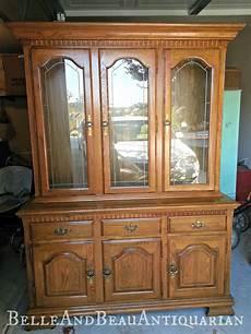 beau antiquarian distressed white china cabinet