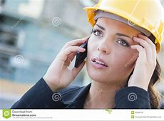 Worried Female Contractor Wearing Hard Hat On Site Using Phone Stock Photography   Image: 32349712