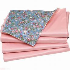 4 pack washable bed pad floral print with pink vinyl