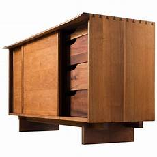 george nakashima two sliding door cabinet in walnut for