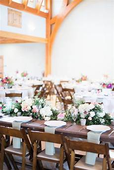 wedding centerpiece on farmhouse table elizabeth anne