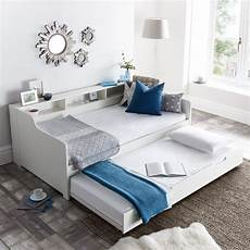 white wooden day bed with guest bed trundle