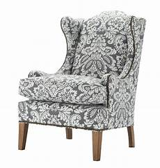 a classic wing chair in a denim colored damask edenton