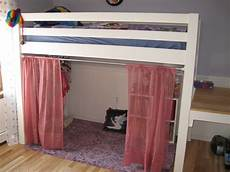 white junior bunk bed with curtains and dress area