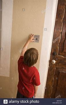 Turn Bedroom Lights Off Seven Year Old Boy Turning Off Light Switch At Home To