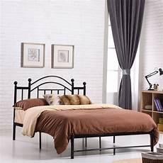 size black platform bed frame with metal slats and