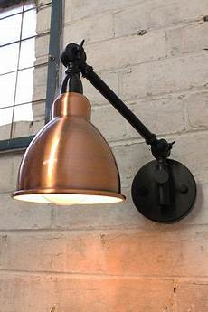 industrial swing arm wall l with brushed copper shade