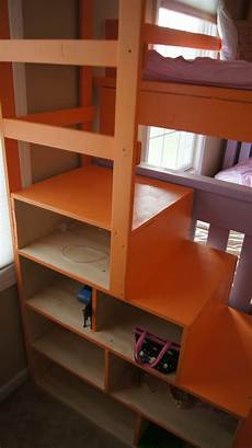 white simple bunk bed with a twist and cubby