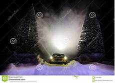 Snow Lights Car Car Lights At Nighttime In Pine Forest With Snow Car
