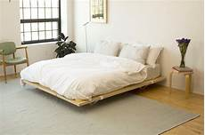 the floyd platform bed frame with parachute sheets zen