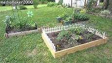 how to make cheap raised beds with border fences diy
