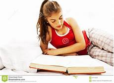 reading book in bed stock photos image 23172543