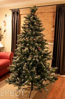 How To Wrap A Large Tree With Christmas Lights Epbot How To Shrink Wrap Your Christmas Tree For Fun