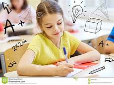 of school writing test in classroom stock