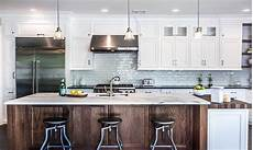 walnut kitchen island kitchen with white marble like counters transitional