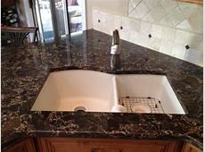 Cambria Laneshaw countertops with Laneshaw tile inserts in the backsplash. Fabricated and