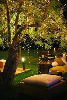 Dangling Fairy Lights Garden At Lit Night With Fairy Lights Dangling From The