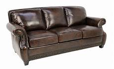 a tobacco colored leather three seat sofa with rivets