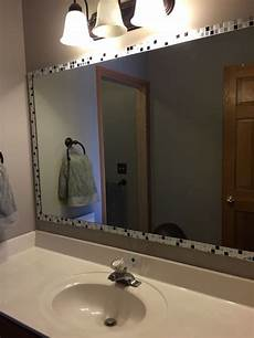home decor bathroom added strips of peel and stick tile to edge of mirror
