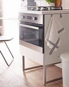 modern white ikea kitchen with free standing units