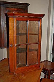 early 19th century walnut glazed corner cabinet la77673