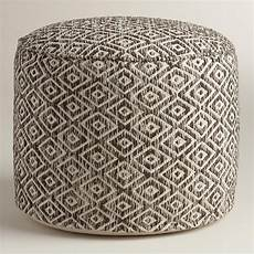 brown and white wool pouf world market 99