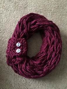 arm knit infinity scarf with matching bling button cuff on