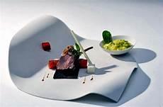 Designer Dishes Design Porcelain Plates With Unusual Fluid Shapes