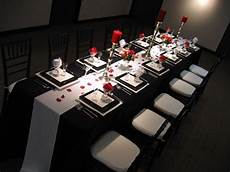 elegant black and white wedding table setting with red